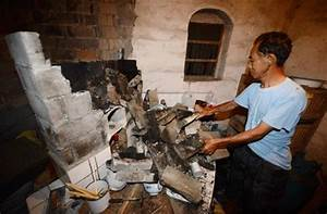 An Earthquake Victim Inspects Damage At His Shattered Home