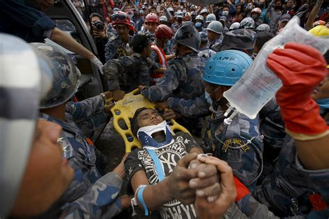 nepal earthquake rescues survivors pulled   rubble