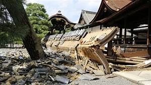 Japan surveys damage after 100mph typhoon causes ...