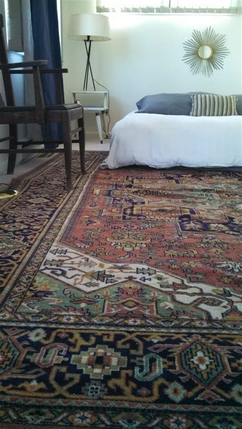 master bedroom persian heriz rug  rust green  navy