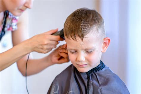 Handsome Little Boy Getting A Hair Cut Stock Photo Womens Haircut 2018 2014 Haircuts For Long Hair Afro With Parts Boy Curly James Hetfield 2016 Bloomington Il Top 5 Guys Fall