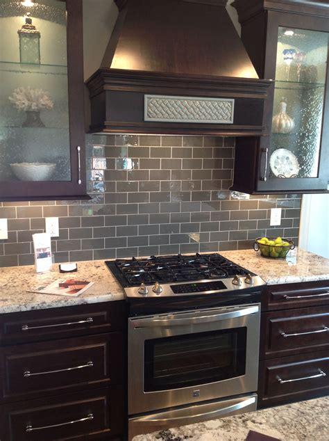 kitchen backsplash glass gray glass subway tile brown cabinets subway