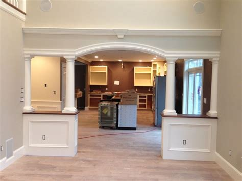 arched opening walnut walls columns finish work dining room walls
