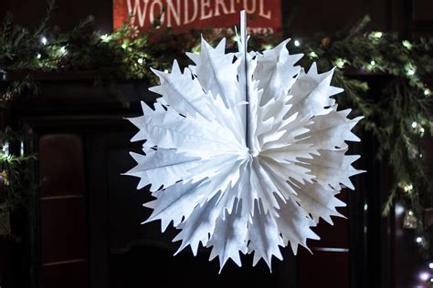 Hanging Decorations - pack of 12 paper snowflake hanging decorations