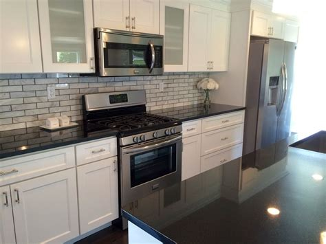 white cabinets black granite what color backsplash transitional black white kitchen by blankspace llc