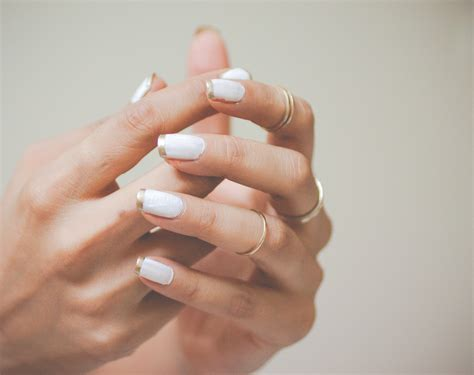 gold french manicure style inked