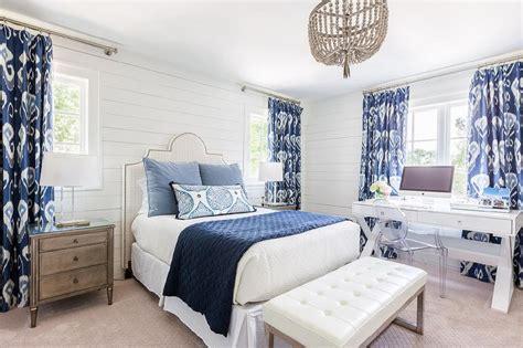 white  blue bedroom  gray beaded chandelier