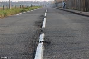 Kent County Council paints white lines on potholed road ...