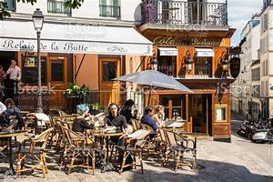 Traditional Restaurant In The Butte Montmartre Paris France Stock Photo - Download Image Now ...