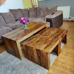 Round in shape, this brown coffee table features smooth top with elevated edges that secure objects from falling. Gorgeous Solid Mango Wood Coffee Table and Nest of Tables.   eBay