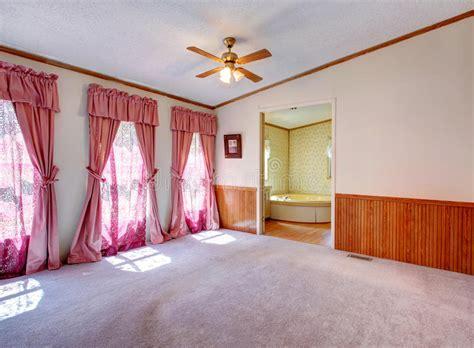 empty bedroom  nice window treatment stock photo