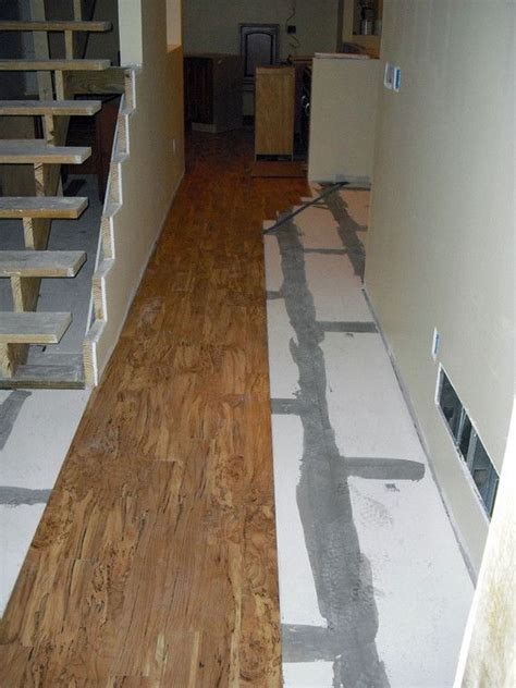 linoleum flooring looks like linoleum flooring that looks like wood goes down over the sealed moisture barrier photo by