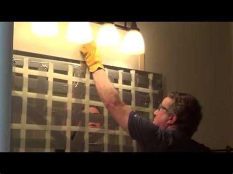 remove  glued bathroom mirror   wall