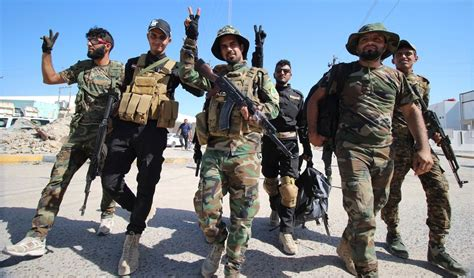 iraqi sunnis join shia militias  fight  militants
