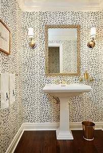 Chic powder room boasts walls clad in Thibaut Tanzania ...