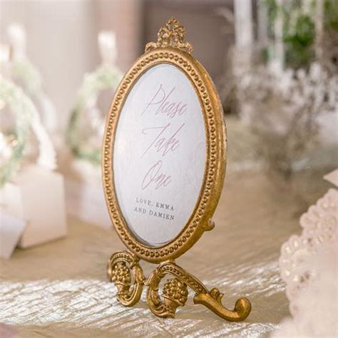 gold oval baroque frame wedding party table decor candy