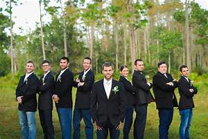 The grooms attendants wore jeans white buttondown shirts and black blazers for a countrychic ...