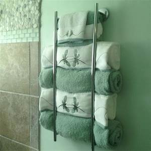 18 diy towel storage ideas to easily organize the bathroom for Storing towels in the bathroom