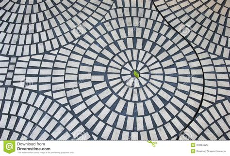 green leaf  circular brick pattern stock image