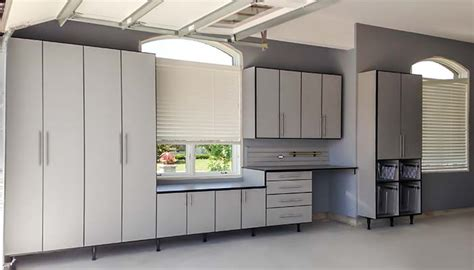 custom garage cabinets garage with custom cabinetry and metallic finish