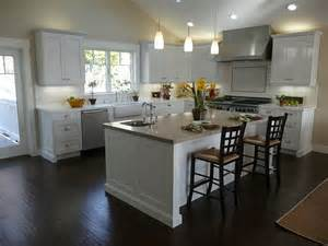 white kitchen wood island kitchen black wooden floor simple chandelier white kitchen island modern kitchen chimney