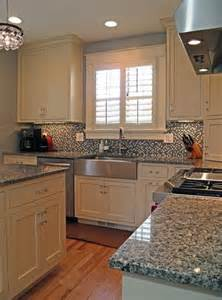 azul platino countertop with white cabinets the busy