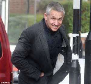 Gary Lineker protects his new 'do from the rain after trip ...
