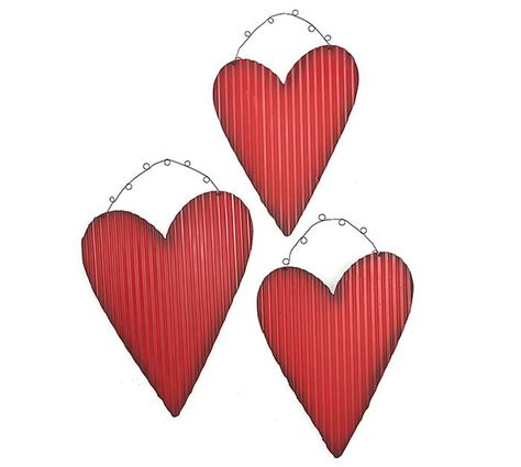 Fill your home with incredible, rustic designs. #burtonandburton Hand-painted red corrugated tin heart ...