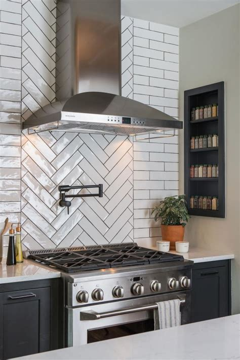 modern black  white kitchen  white herringbone tile