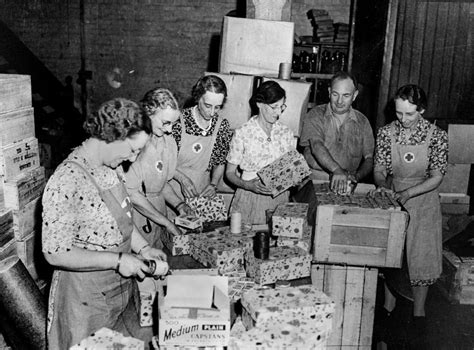 filestatelibqld   red cross workers packing