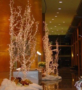 lighted tree branches wedding reception entrance