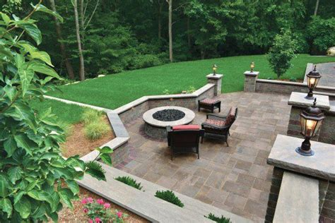 unilock patio ideas benefits of enclosing your patio with retaining walls or