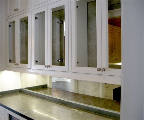mirrored kitchen cabinets place the mirrored cabinet doors in your kitchen