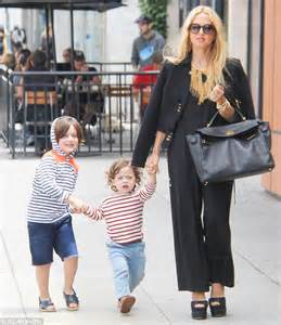 Rachel Zoe is a stylish mum in a black jumpsuit with cute ...