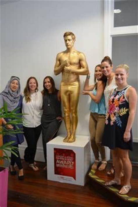 human statue bodyart  gold living statue