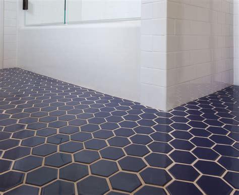 blue hexagon tile bathroom floor cabinet hardware room
