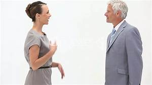 Business people shaking hands against a white background ...