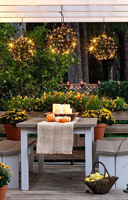 holiday lighting ideas for decks surround a metal globe with bright led light strings for a hanging decoration to