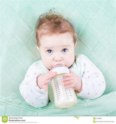 Cute Little Baby Drinking Milk Formula Out Of Bottle Stock