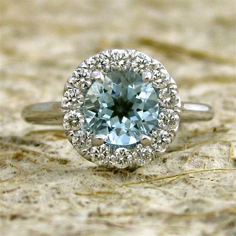 The Meaning Of Aquamarine Birthstone Engagement Rings. Story Wedding Rings. Motorcycle Club Rings. Extra Large Engagement Rings. Pittsburgh Steelers Rings. 3 Cord Wedding Rings. Dinner Wedding Rings. Pale Pink Engagement Rings. Round Classic Engagement Rings