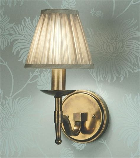 single or arm antique brass wall light