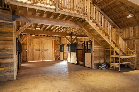 horse stalls  storage space wood post  beam barn