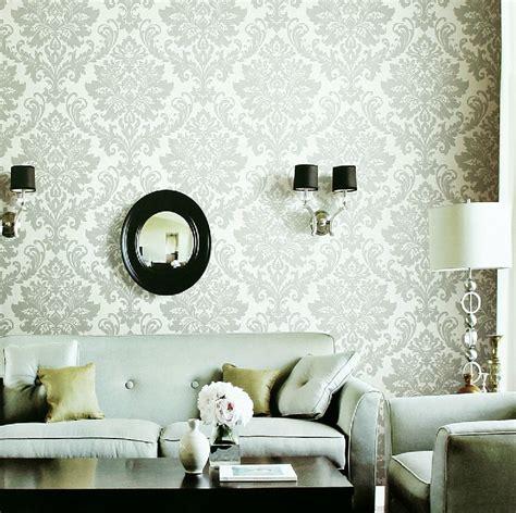 livingroom wallpaper white gray fleur de lis wallpaper living room interior design ideas