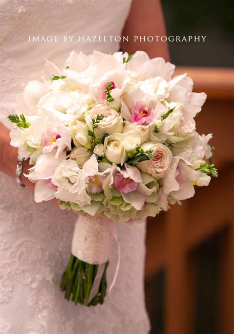 featured bouquet white orchid and garden rose bouquet