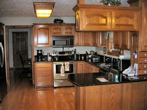 honey oak kitchen cabinets with granite countertops lake area custom with guest house shop pole barn near