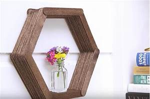 By Using Only Popsicle Sticks And Glue, She Makes A DIY