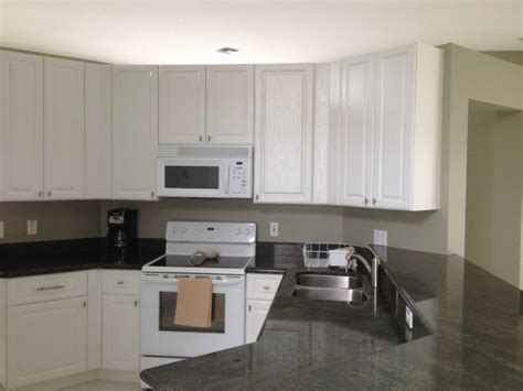 white wood grain kitchen cabinets paula and frank s kitchen reface white thermofoil with 1883
