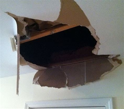 ceiling fan repair near me how to easily fix a hole in your ceiling or walls drywall