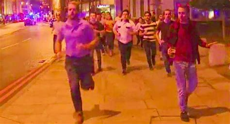 running beer guy london terror hand symbol away attack bridge becomes spirit unilad
