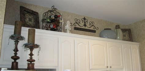top of cabinet decor what to decorate the top of kitchen cabinets with home